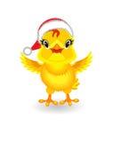 Gelbes Huhn im Hut von Santa Claus auf weißem Hintergrund Lizenzfreies Stockfoto