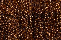 Gelbes Licht, das durch Zoomtechnikhintergrund und -beschaffenheit in der Nacht verbreitet Stockfotografie