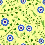 Gelbes Muster mit blauen Blumen und Gras Stockbild