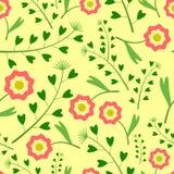 Gelbes Muster mit Blumen und Gras Stockbild