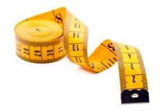 Gelbes Schneidermeßinstrument Stockfotografie