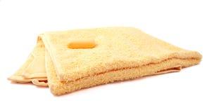 Gelbes Tuch und Seife Stockfotos