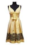 Gelbes weibliches Kleid Stockbild