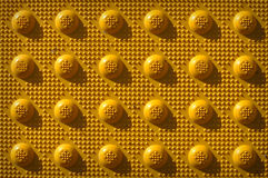 Gelbes Wiederholungs-Knopf-Muster stockbild