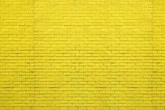 Gelbes Ziegelsteinmuster auf Wand für abstrakten Hintergrund Lizenzfreies Stockfoto