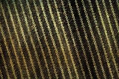 Gelblicher schwarzer grunge Gewebe-Beschaffenheitshintergrund Stockfotografie