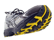 Gelbschwarz-Schritmuster des laufenden Schuhes kippte oben Stockfotografie