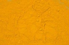 Gelbwurzgewürz-Hintergrundbeschaffenheit Stockfotografie