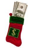 Geld angefüllt in einem Weihnachtsstrumpf Lizenzfreie Stockfotos