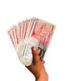 Geld angehaltenes in der Hand - BRITISCHES Bargeld Lizenzfreie Stockbilder