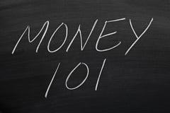 Geld 101 auf einer Tafel Lizenzfreie Stockfotos