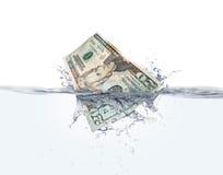 Geld auf Wasser Stockfotografie