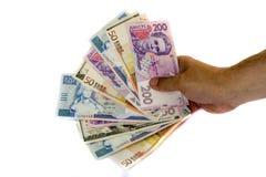 Geld: benamingen van de verschillende landen stock fotografie