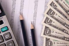 Geld, calc en Grafiek stock foto