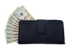 Geld, das aus Geldbörse heraus haftet Lizenzfreie Stockfotos