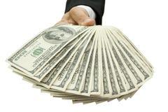 Geld in de hand Royalty-vrije Stock Afbeeldingen