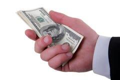 Geld in de hand van mensen Stock Foto's