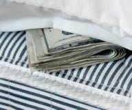 Geld in de Matras Stock Afbeelding