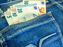 Geld in de zak royalty-vrije stock foto's