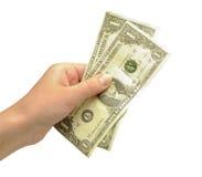 Geld in den Dollar in der Hand stockfotos