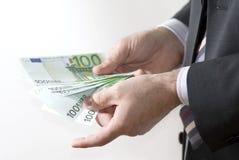Geld in den Händen Stockbild