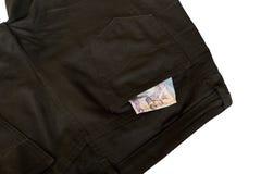 Geld in den kurzen Hosen Lizenzfreies Stockfoto