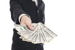 Geld in den menschlichen Händen Stockbilder