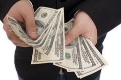 Geld in den menschlichen Händen Stockbild