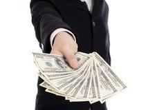 Geld in den menschlichen Händen Lizenzfreie Stockfotos