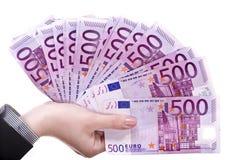Geld in den weiblichen Händen. lizenzfreie stockfotografie