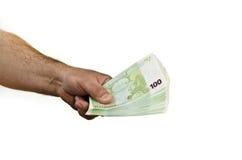 Geld in der Hand, getrennt auf weißem Hintergrund Stockbilder