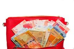 Geld in der Handtasche Stockfotografie