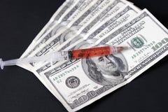 Geld in der Medizin Stockfotos