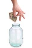 Geld in der Querneigung Stockfoto