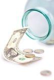 Geld in der Querneigung Stockbild