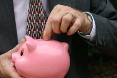 Geld in der Querneigung Lizenzfreie Stockbilder