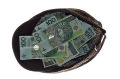 Geld in der Schutzkappe Lizenzfreies Stockfoto
