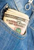 Geld in der Tasche lizenzfreies stockbild