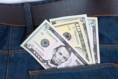 Geld in der Tasche Stockfotos