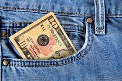 Geld in der Tasche Stockfoto