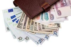 Dollar, Euros, Russe Robles in der Geldbörse Lizenzfreies Stockbild