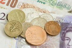 Geld des britischen Sterling Stockbilder