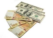 Geld Dolars und des hryvnia Stockbilder