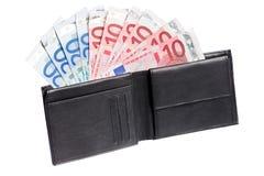 Geld in een beurs Stock Afbeelding