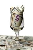 Geld in een glas stock foto