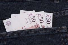 Geld in een zak stock foto's