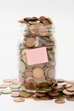 Geld in einem Glas Stockbild