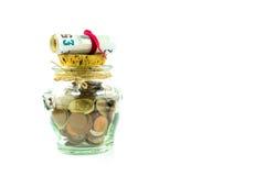 Geld in einem Glas Stockfotos