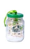 Geld in einem Glas Lizenzfreie Stockfotografie