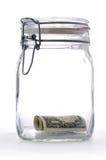 Geld in einem Glasglas Stockbild